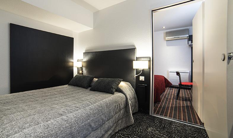 Un ou plusieurs lits dans un hébergement de l'établissement Citotel Stim'Otel